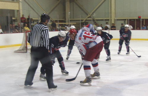 Derek Stepan sets up against Georgi Guryanov