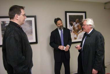 Team Russia assistant coach Andrei Nazarov (left) talks with NHL agent Paul Theofanous and Rangers GM Glen Sather (right) in Newark. Photo: Vasily Osipov, Sport Express.