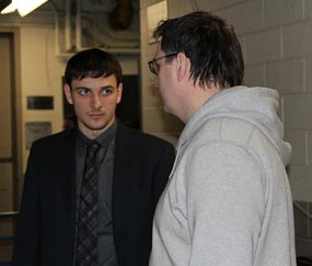 Artem Anisimov talks to Andrei Nazarov following the New York Rangers loss to the Buffalo Sabres on March 3, 2011.